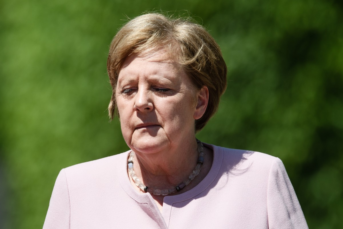 Angela Merkel says she is well despite suffering visible tremors