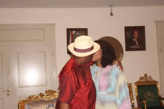 Wike celebrates victory at tribunal with a kiss with his wife