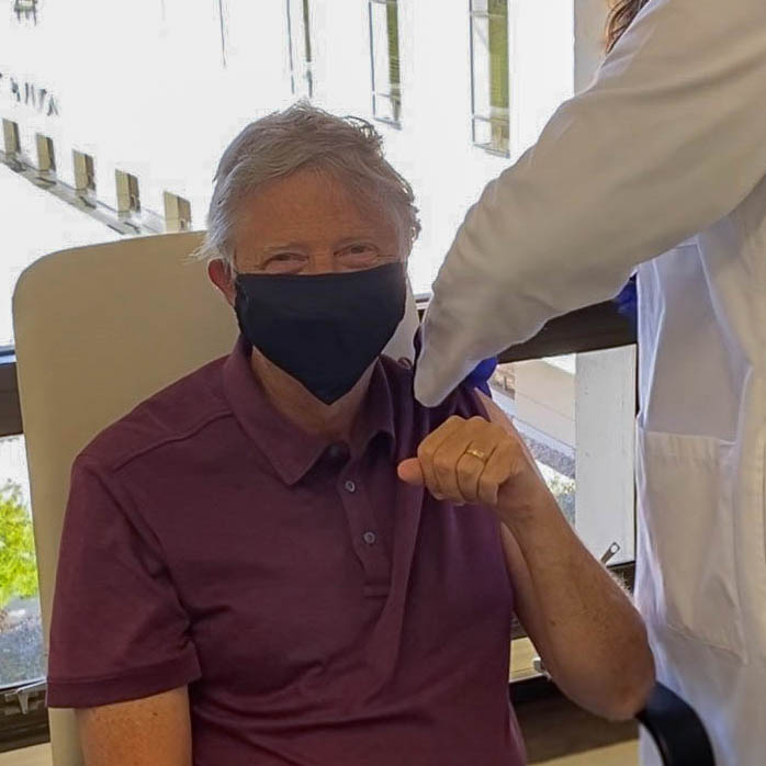 Bill Gates takes a shot of Covid-19 vaccine
