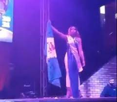 Beauty pageant contestant walks runway with blood stained Nigerian flag (Video)